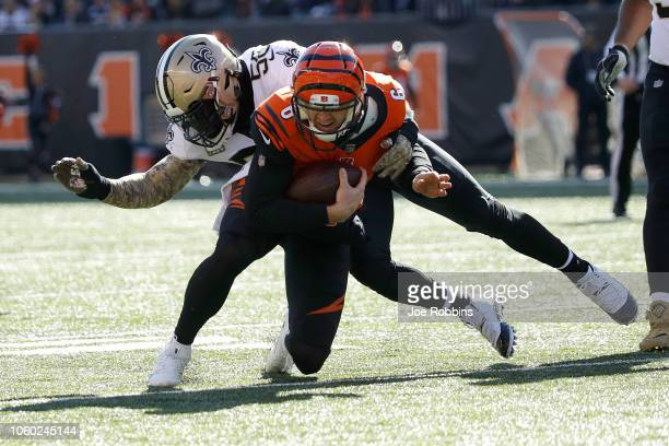 Demario Davis of the New Orleans Saints tackled Jeff Driskel of the Cincinnati Bengals during the first quarter at Paul Brown Stadium on November 11...