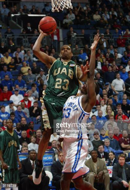 Demario Eddins of the UAB Blazers goes up for a shot over Antwain Barbour of the Kentucky Wildcats as the Blazers upset the Wildcats 76-75 during the...