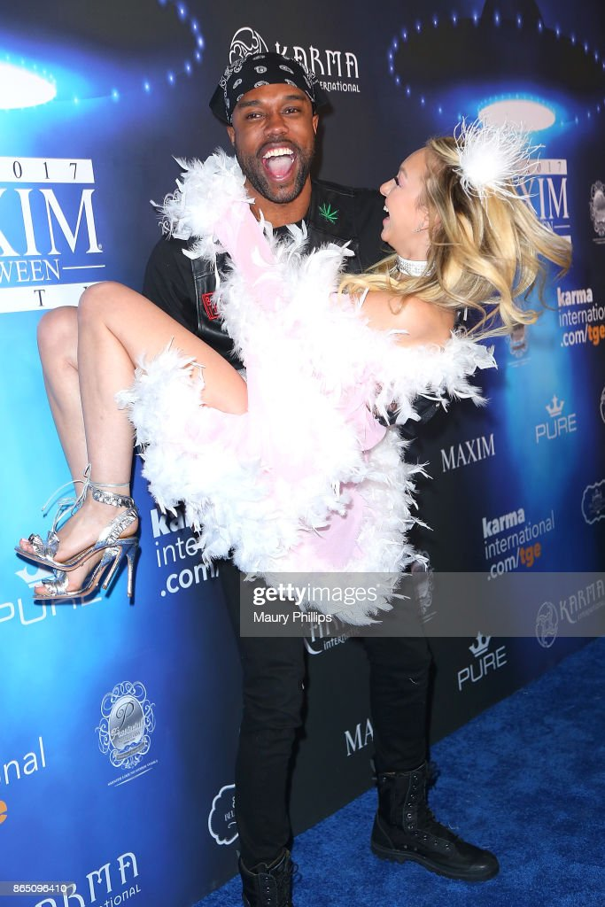 DeMario Jackson and Corinne Olympios arrive at the 2017 Maxim Halloween Party at Los Angeles Center Studios on October 21, 2017 in Los Angeles, California.