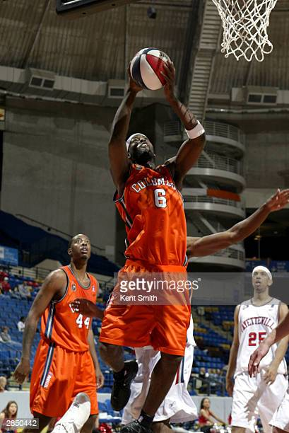 Demario Jones of the Columbus Riverdragons shoots against the Fayetteville Patriots during the game at Crown Coliseum on December 12, 2003 in...