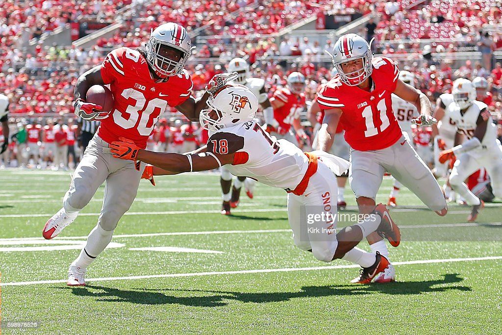 Demario McCall #30 of the Ohio State Buckeyes stiff arms Cameron Jefferies #18 of the Bowling Green Falcons while carrying the ball during the fourth quarter on September 3, 2016 at Ohio Stadium in Columbus, Ohio. Ohio State defeated Bowling Green 77-10.