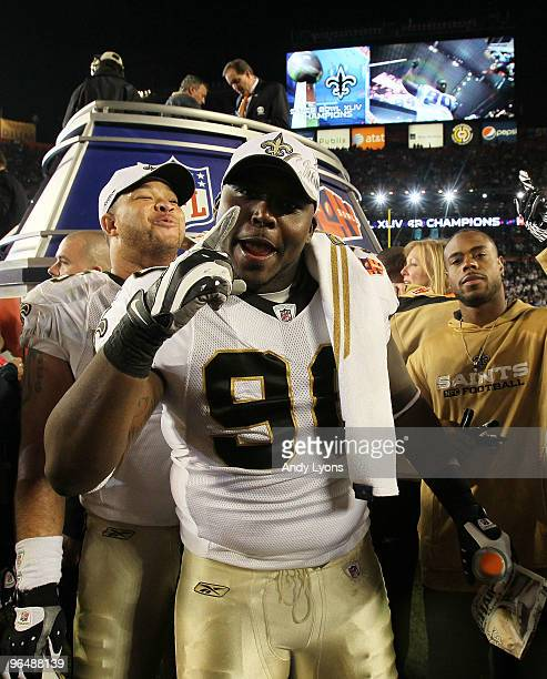 DeMario Pressley of the New Orleans Saints celebrates after the Saints defeated the Indianapolis Colts during Super Bowl XLIV on February 7 2010 at...