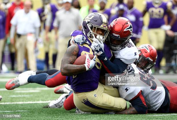 DeMarquis Gates of Memphis Express tackles Tarean Folston of Atlanta Legends during the first half in the Alliance of American Football game at...