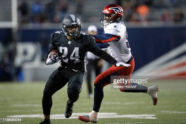 DeMarquis Gates of the Memphis Express grabs Marshaun Coprich of the Birmingham Iron during the first quarter of their Alliance of American Football...