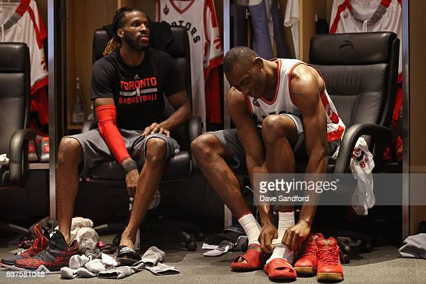 DeMarre Carroll and Bismack Biyombo of the Toronto Raptors get ready before Game Six of the NBA Eastern Conference Finals against the Cleveland...