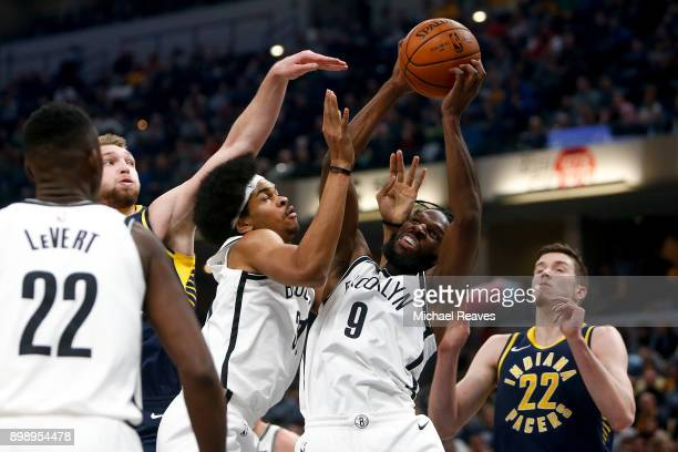 DeMarre Carroll and Jarrett Allen of the Brooklyn Nets fight for a rebound with Domantas Sabonis and TJ Leaf of the Indiana Pacers during the first...