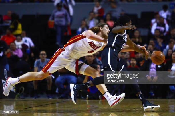 Demarre Carroll of Brooklyn Nets Nets passes the ball against Kelly Olynyk of Miami Heat during the NBA game between the Brooklyn Nets and Miami Heat...