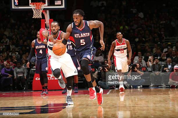 DeMarre Carroll of the Atlanta Hawks brings the ball up court against the Washington Wizards on November 25 2014 at the Verizon Center in Washington...