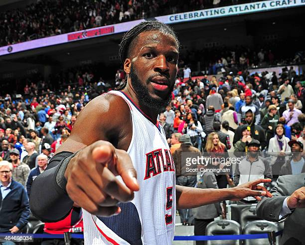 DeMarre Carroll of the Atlanta Hawks celebrates after the game against the Orlando Magic on February 27 2015 at Philips Arena in Atlanta Georgia NOTE...