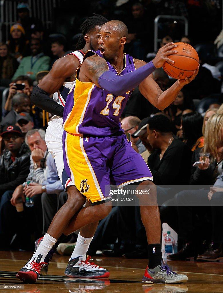 DeMarre Carroll #5 of the Atlanta Hawks defends against Kobe Bryant #24 of the Los Angeles Lakers at Philips Arena on December 16, 2013 in Atlanta, Georgia.