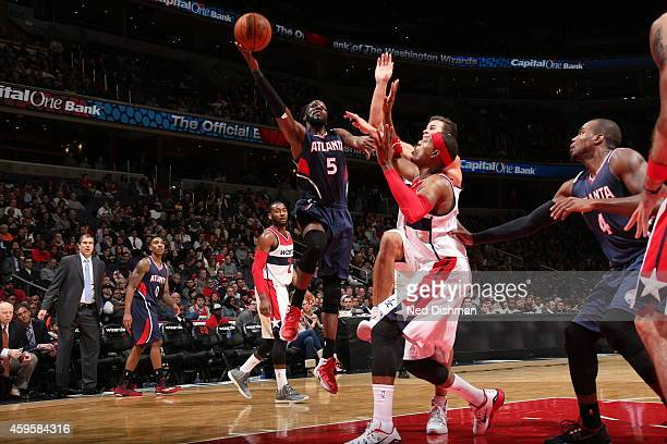 DeMarre Carroll of the Atlanta Hawks goes to the basket against the Washington Wizards on November 25 2014 at the Verizon Center in Washington DC...