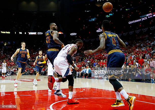 DeMarre Carroll of the Atlanta Hawks injures his left leg in the fourth quarter against the Cleveland Cavaliers during Game One of the Eastern...