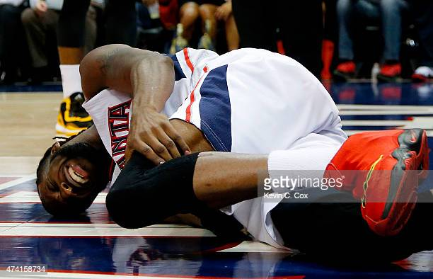 DeMarre Carroll of the Atlanta Hawks reacts after injuring his left leg in the fourth quarter against the Cleveland Cavaliers during Game One of the...