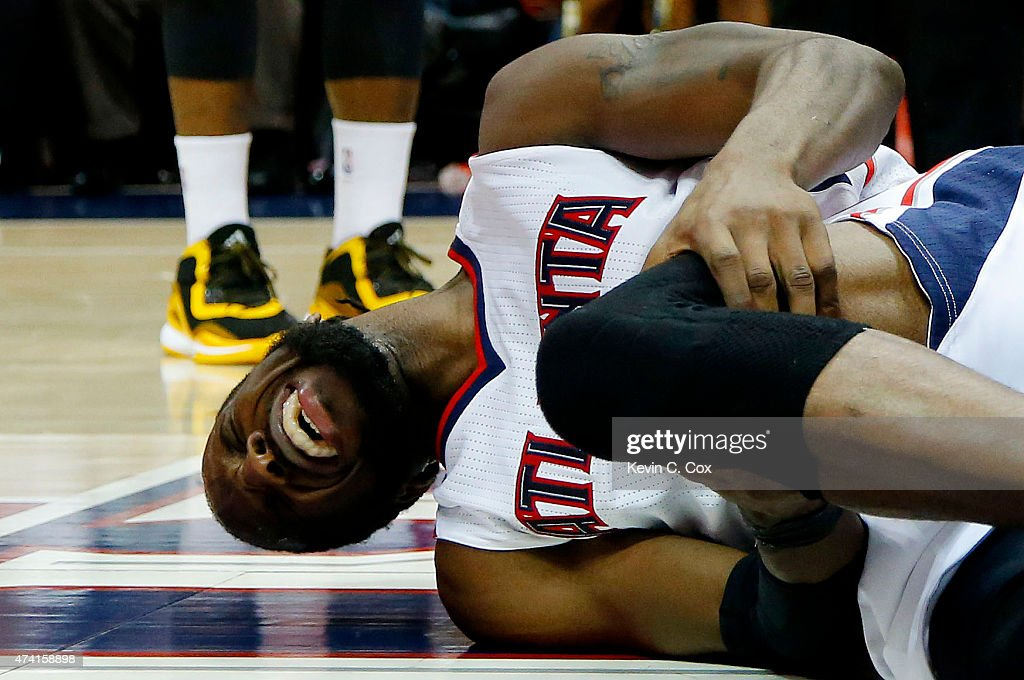 DeMarre Carroll #5 of the Atlanta Hawks reacts after injuring his left leg in the fourth quarter against the Cleveland Cavaliers during Game One of the Eastern Conference Finals of the 2015 NBA Playoffs at Philips Arena on May 20, 2015 in Atlanta, Georgia.