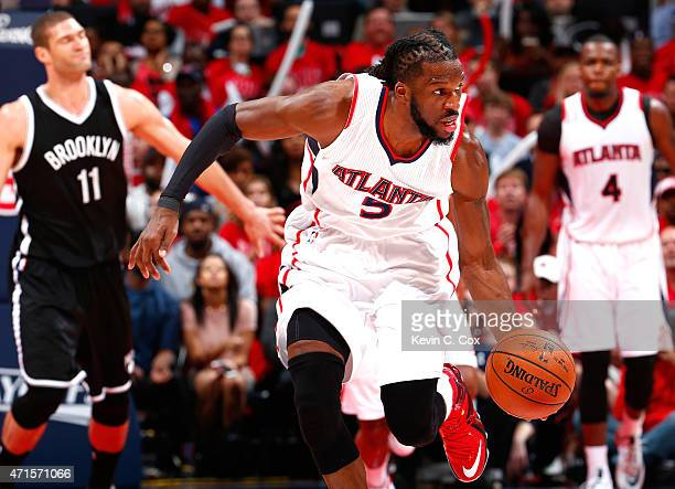 DeMarre Carroll of the Atlanta Hawks recovers a loose ball against the Brooklyn Nets during Game Five of the Eastern Conference Quarterfinals of the...