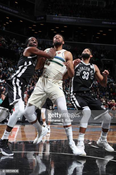 DeMarre Carroll of the Brooklyn Nets boxes out Jabari Parker of the Milwaukee Bucks on February 4 2018 at Barclays Center in Brooklyn New York NOTE...