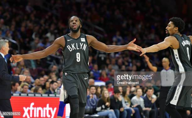 DeMarre Carroll of the Brooklyn Nets celebrates with teammate Spencer Dinwiddie during the game against the Philadelphia 76ers at the Wells Fargo...