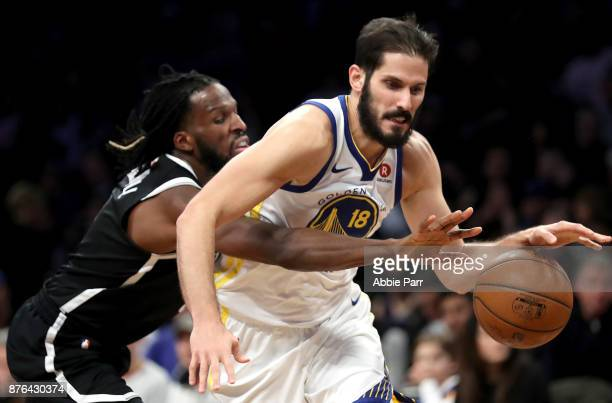 DeMarre Carroll of the Brooklyn Nets defends against Omri Casspi of the Golden State Warriors in the third quarter during their game at Barclays...