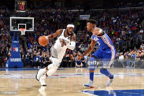 DeMarre Carroll of the Brooklyn Nets drives to the basket Jimmy Butler of the Philadelphia 76ers during Game Two of Round One of the 2019 NBA...