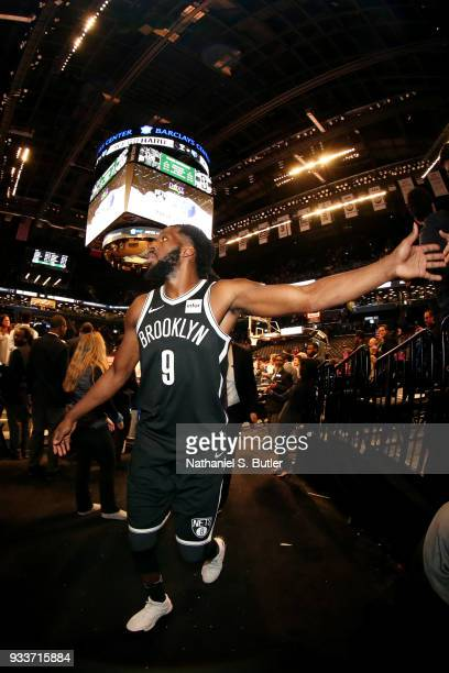 DeMarre Carroll of the Brooklyn Nets exchanges high fives with fans after the game against the Dallas Mavericks on March 17 2018 at Barclays Center...