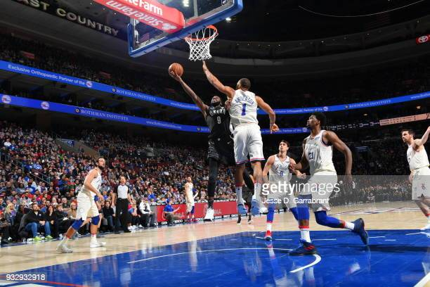 DeMarre Carroll of the Brooklyn Nets goes up for the layup against the Philadelphia 76ers at the Wells Fargo Center on March 16 2018 in Philadelphia...