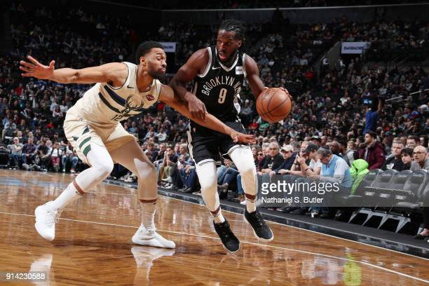 DeMarre Carroll of the Brooklyn Nets handles the ball against Jabari Parker of the Milwaukee Bucks on February 4 2018 at Barclays Center in Brooklyn...