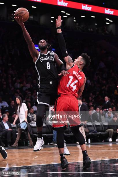 Demarre Carroll of the Brooklyn Nets lays up a shot against Danny Green of the Toronto Raptors during the game at Barclays Center on April 3 2019 in...