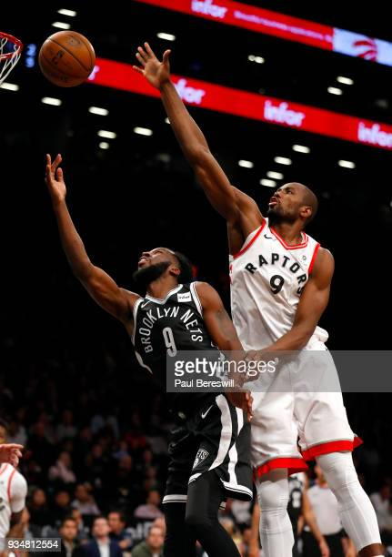 DeMarre Carroll of the Brooklyn Nets lays up a shot in front of Serge Ibaka of the Toronto Raptors in an NBA basketball game on March 13 2018 at...