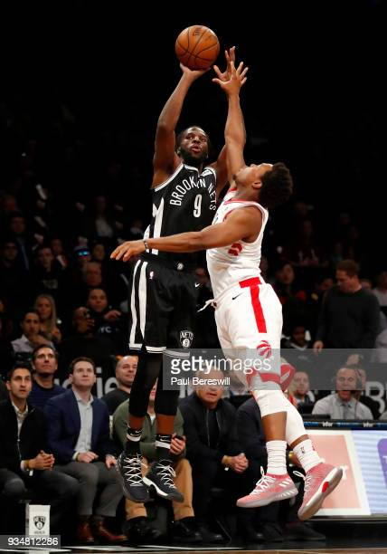 DeMarre Carroll of the Brooklyn Nets shoots a three point shot in an NBA basketball game against the Toronto Raptors on March 13 2018 at Barclays...