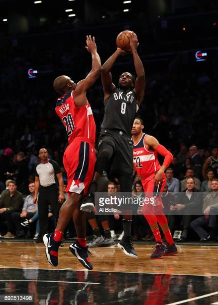DeMarre Carroll of the Brooklyn Nets shoots against Jodie Meeks of the Washington Wizards during their game at Barclays Center on December 12 2017 in...