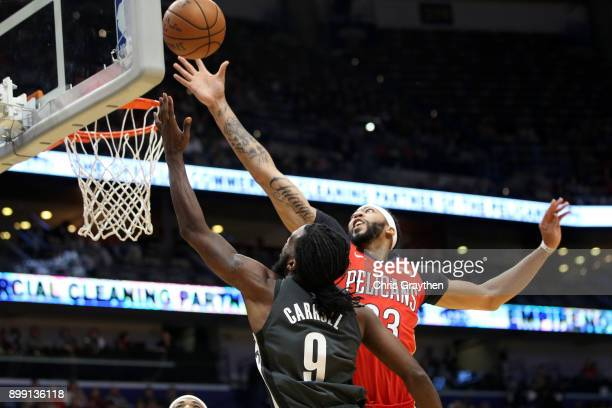 DeMarre Carroll of the Brooklyn Nets shoots the ball over Anthony Davis of the New Orleans Pelicans at the Smoothie King Center on December 27 2017...