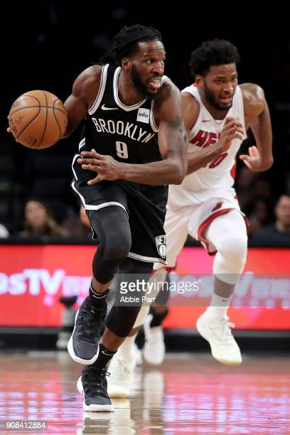 DeMarre Carroll of the Brooklyn Nets works down the court against Justise Winslow of the Miami Heat in the second quarter during their game at...