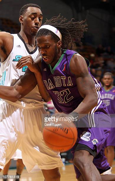 DeMarre Carroll of the Dakota Wizards gets tied up with Anthony Mason of the Sioux Falls Skyforce while driving to the basket in the first half of...