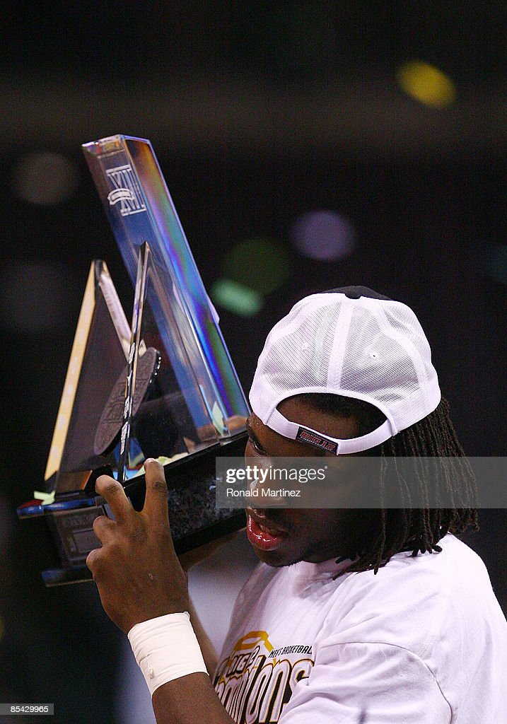 DeMarre Carroll #1 of the Missouri Tigers holds the trophy after winning the Phillips 66 Big 12 Men's Basketball Championship at the Ford Center March 14, 2009 in Oklahoma City, Oklahoma.