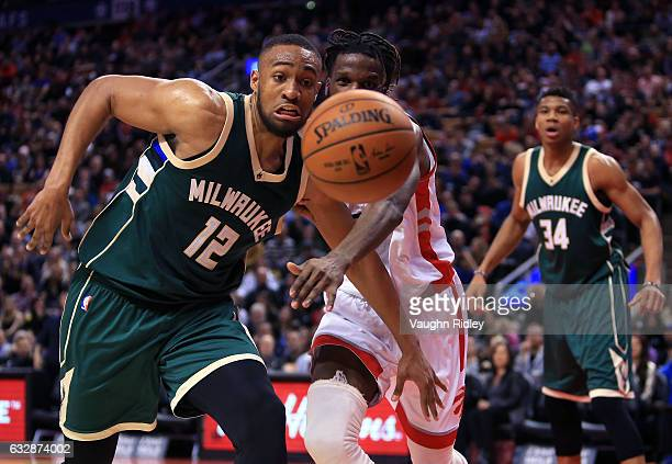 DeMarre Carroll of the Toronto Raptors and Jabari Parker of the Milwaukee Bucks chase a loose ball during the second half of an NBA game at Air...