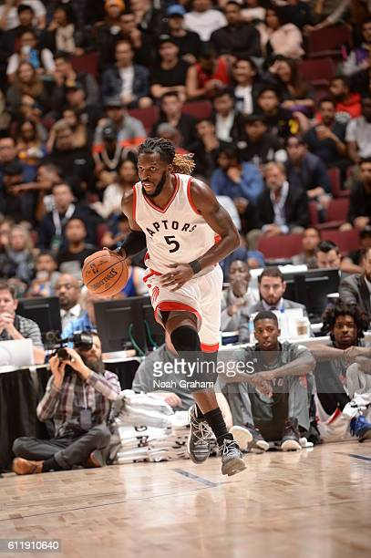 DeMarre Carroll of the Toronto Raptors dribbles the ball against the Golden State Warriors during a preseason game on October 1 2016 at Rogers Arena...