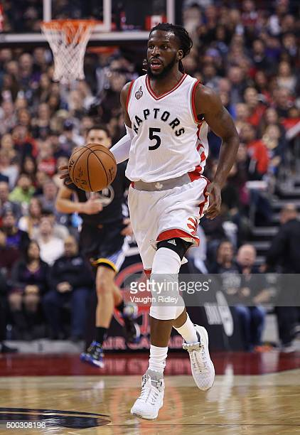 DeMarre Carroll of the Toronto Raptors dribbles the ball during an NBA game against the Golden State Warriors at the Air Canada Centre on December 05...