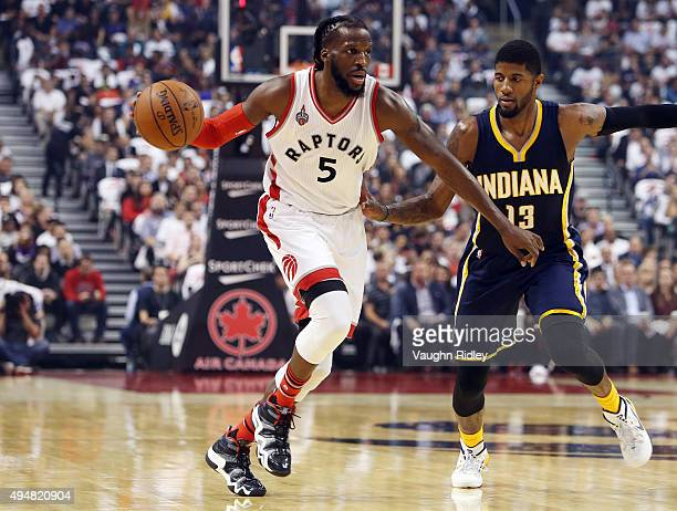 DeMarre Carroll of the Toronto Raptors dribbles the ball during the NBA season opener against the Indiana Pacers at Air Canada Centre on October 28...