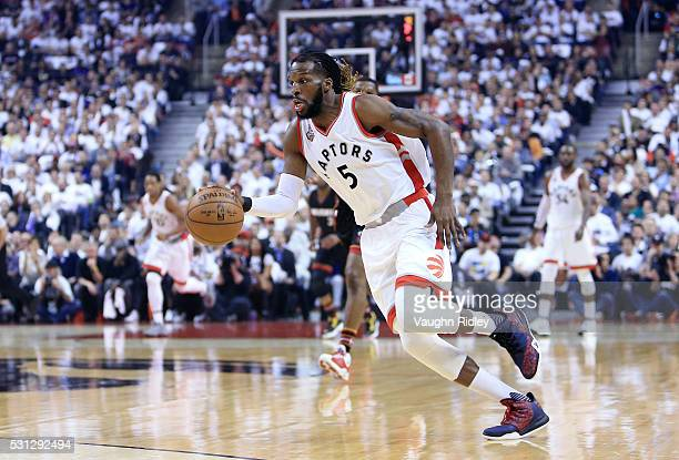 DeMarre Carroll of the Toronto Raptors dribbles the ball in the first half of Game Five of the Eastern Conference Semifinals against the Miami Heat...