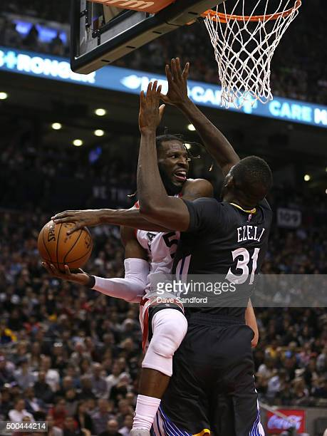 DeMarre Carroll of the Toronto Raptors drives to the basket against the Golden State Warriors December 5 2015 at Air Canada Centre in Toronto Ontario...