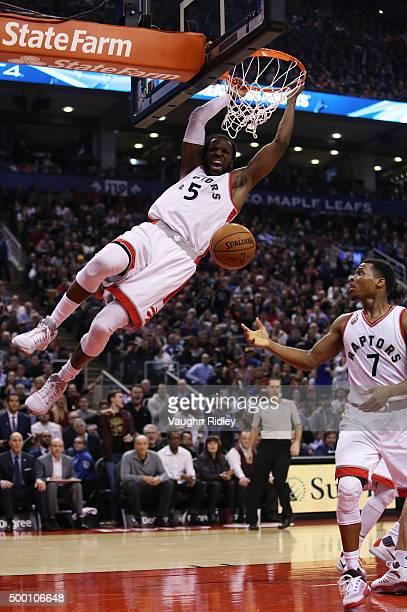 DeMarre Carroll of the Toronto Raptors dunks the ball during an NBA game against the Golden State Warriors at the Air Canada Centre on December 05...