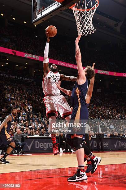 DeMarre Carroll of the Toronto Raptors goes to the basket against the New Orleans Pelicans on November 13 2015 at the Air Canada Centre in Toronto...