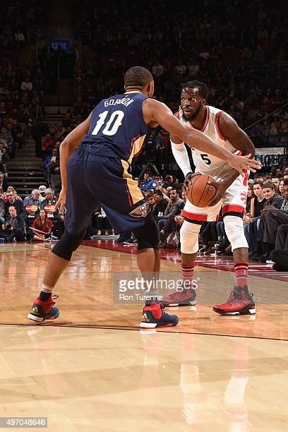 DeMarre Carroll of the Toronto Raptors handles the ball against Eric Gordon of the New Orleans Pelicans on November 13 2015 at the Air Canada Centre...