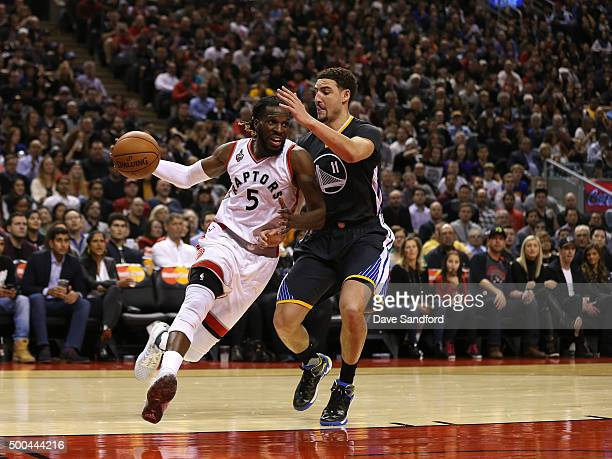DeMarre Carroll of the Toronto Raptors handles the ball against Klay Thompson of the Golden State Warriors December 5 2015 at Air Canada Centre in...