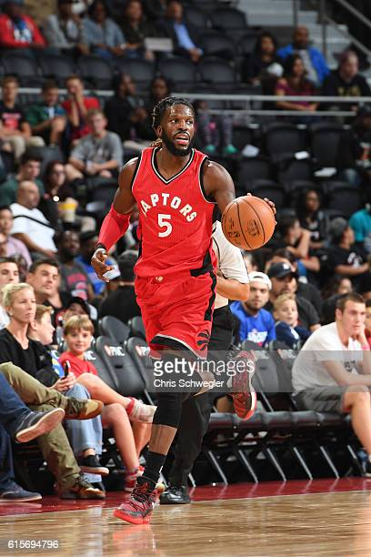 DeMarre Carroll of the Toronto Raptors handles the ball against the Detroit Pistons on October 19 2016 at The Palace of Auburn Hills in Auburn Hills...