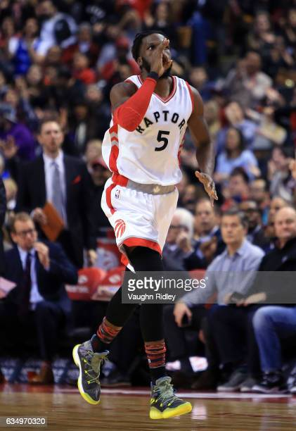 DeMarre Carroll of the Toronto Raptors reacts after sinking a 3 pointer during the first half of an NBA game against the Detroit Pistons at Air...