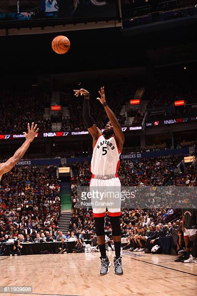 DeMarre Carroll of the Toronto Raptors shoots against the Golden State Warriors during a preseason game on October 1 2016 at Rogers Arena in...