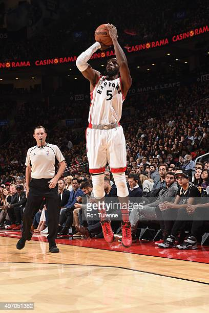 DeMarre Carroll of the Toronto Raptors shoots against the New Orleans Pelicans on November 13 2015 at the Air Canada Centre in Toronto Ontario Canada...