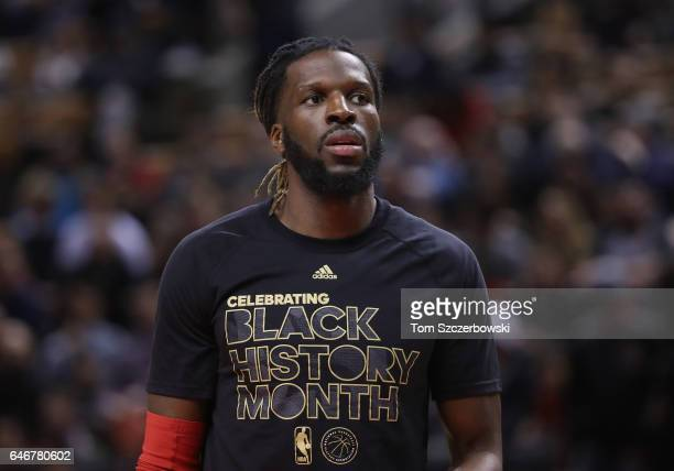 DeMarre Carroll of the Toronto Raptors warms up while wearing a Black History Month shirt before the start of their game against the Portland Trail...
