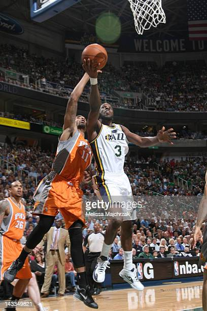 DeMarre Carroll of the Utah Jazz goes to the hoop around Markieff Morris of the Phoenix Suns at Energy Solutions Arena on April 24 2012 in Salt Lake...